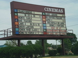Attraction board of Rave Cinemas in Flint MI with old Showcase lettering covered over