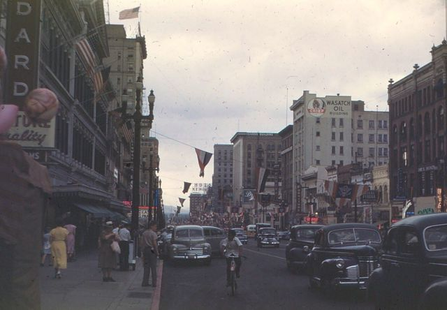 Uptown marquee is barely visible on the left in the background.