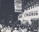 <p>Midwest Theatre, Oklahoma City, Dec. 2, 1960 World Premiere showing of Cimarron. Premiere followed by lot's of festivities i.e. parade, dinners, & party's. Harvey street was blocked off between Grand Ave & Main Street. Band played on street while bright beaming lights pointed skyward. Attending stars included: Glenn Ford, Maria Schell, Anne Baxter & Russ Tamblyn. Movie played reserve seats for 6 record breaking weeks.</p>