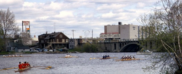 White City Theatre seen in background of crew race on Lake Q, spring 1967