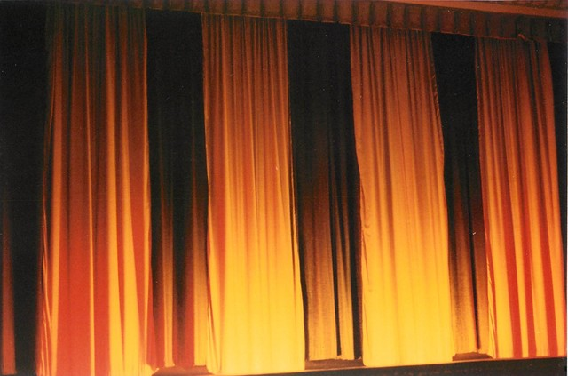 State Theatre - curtain closed and warmed by foot lights