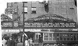 Paramount Theater at 385 Flatbush Avenue on the corner of DeKalb 1931 photo by George Mann who is on the marquee Via www.thegeorgemannarchive.com/ courtesy of Dianne Woods