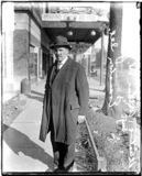 Detective Arthur W. Johnston, of Evanston, Illinois, standing on a North Milwaukee Street sidewalk in the West Town community area