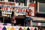 "<p>A parade passes down Washington Ave, while inside the theater fans are enjoying the ""Thrilling Kung-Fu Action"" of Bruce Lee in Enter The Dragon…</p>"