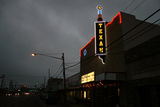 Texan Theater on cloudy night